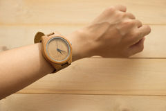 Top view. young woman equip wooden wrist watch on her arm have w Royalty Free Stock Photos