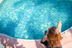 Top View Young woman Living. By the pool in the morning in the summer Royalty Free Stock Image