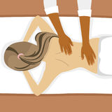 Top view of young woman receiving back massage in spa salon Royalty Free Stock Photography