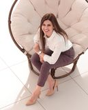 Top view.young woman sitting in soft round chair. The concept of comfort royalty free stock photography