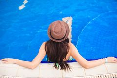 Top view of a young woman wearing hat in the pool Stock Photo
