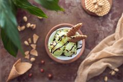 Top view of yummy pistachio ice cream with waffles in glass. On table royalty free stock photo
