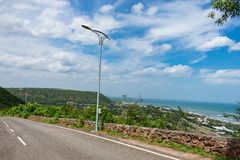 Awesome view of sea beach & blue sky scenery from a top of a mountain road. royalty free stock photos