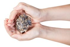 Top view of zinc and lead mineral ore in handful Stock Photos