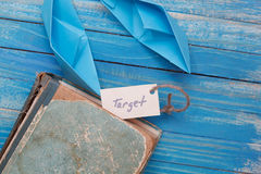 Top Viewed vintage book and paper boats with a sign - target Stock Images
