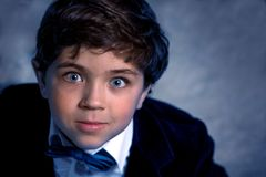 Top viewing portrait of cute young boy with expressive eyes.  stock images
