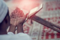 Top viewv of African Muslim Man Making Traditional Prayer To God While Wearing A Traditional Cap Dishdasha Royalty Free Stock Photo