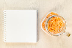 Top viiew of blank notebook and closeup Iced milk tea, Thai Ice Stock Photography