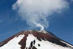 Top of volcanic cone Avachinsky Volcano, fumarolic activity of volcano. Kamchatka, Russia. Avacha Volcano - active volcano of Kamchatka Peninsula. View of top of Royalty Free Stock Photo