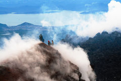 On the top of volcano. Kamchatka. The Tourists look at the Pacific ocean with of the volcano. Kamchatka Stock Images