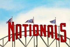 Top of the Washington Nationals Scoreboard. Flags fly above the top of the Washington Nationals scoreboard in Washington DC Stock Photos