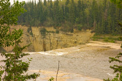 The top of a waterfall in northern canada Royalty Free Stock Photos