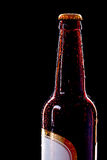 Top of wet beer bottle. Isolated on black Royalty Free Stock Photography