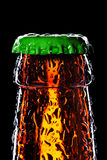 Top of wet beer bottle. Isolated on black Stock Images