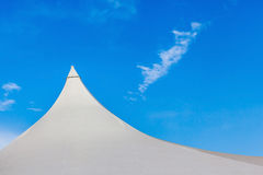Top of white canvas tent against blue sky background. Royalty Free Stock Photography