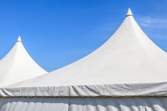Top of white canvas tent with clear blue sky background Stock Photo