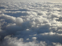 On top of white fluffy curvy clouds Stock Photos