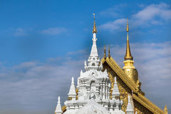 Top of white pagoda and top golden pagoda in wat phra that hariphunchai temple Royalty Free Stock Images