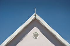 Top of white roof with blue skies Stock Photo