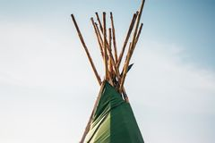 Top of a wigwam structure. Top half abstract view of a wigwam structure stock photography
