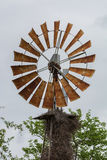 The top of a windmill with a birds nest Stock Photography