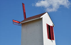 Isolated windmill tower with red sails Royalty Free Stock Image