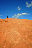 On top of the wolrd. The contrast of grand nature and small human being Stock Photography