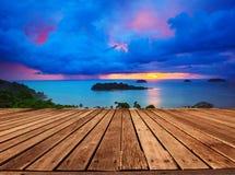 Top wood panel terrace with beautiful dramatic sky of sun set an Stock Photography