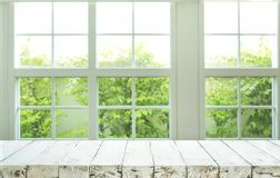 Top of wood table counter on blur window view garden background Stock Images