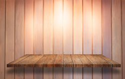 Top of wooden shelf with spot light on wooden wall background Stock Photo