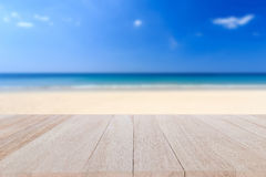 Top wooden table and blur of tropical beach background Stock Photo