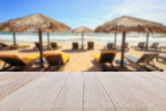 Top wooden table and blur of tropical beach background royalty free stock image