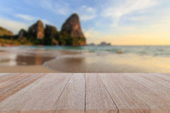Top wooden table and blur of tropical beach background Royalty Free Stock Photo