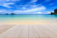 Top wooden table and blur of tropical beach background Stock Photos