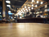 Top of Wooden table with Blurred Bar restaurant background. Top of Wooden table with Blurred Bar Interior restaurant background royalty free stock photos