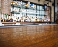 Top of wooden table counter with blurred bar Background Royalty Free Stock Images