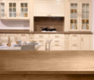 Top of wooden table and kitchen space Royalty Free Stock Photos