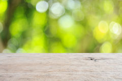 Top wooden table with sunny abstract green nature background, bl Stock Photo