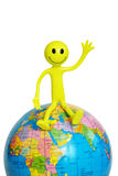 """On top of the world"". ""On top of the world"" - smilie sitting on the globe Royalty Free Stock Image"