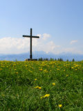 On top of the world. Wooden cross on top of mountain Stock Photo