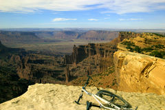 On top of the world. A mountain bike lying on its side at the top of a cliff in the desert near Moab, Utah Stock Photography