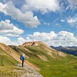 On top of the World. Hiker with grand view of the Rocky Mountains stock photo