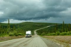 Top of the World highway. Camper on unpaved Top of the World highway in Alaska royalty free stock image