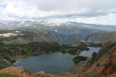 Top of the World. Mountain  lake stormy sky beautiful Stock Photos