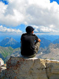 On Top of the World. Sitting on top of the famous Zugspitze Mountain in Germany, gazing over the European Alps Royalty Free Stock Photo