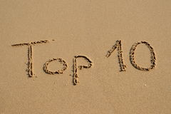 Top 10 writing. The phrase Top 10 written in the wet sand at the beach Royalty Free Stock Photos
