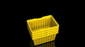 Top Of Yellow Shopping Baskets On Black Background stock video footage