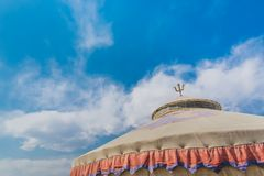 The top of the yurt building under the blue sky and white clouds stock images