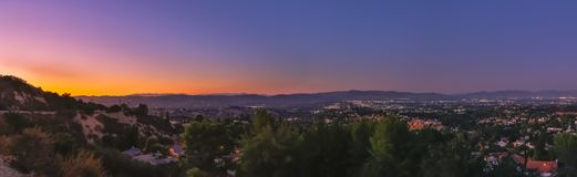 Topanga Overlook Panorama. The Top O` Topanga Overlook at sunset with views of the mountains and the San Fernando Valley royalty free stock image