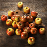 Topaz apples and wooden grater. On wooden table Stock Images